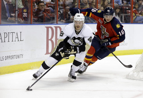 Pittsburgh Penguins' Joe Vitale, left, skates with the puck as Florida Panthers center Aleksander Barkov (16) pursues during the first period of an NHL hockey game Saturday, Nov. 30, 2013, in Sunrise, Fla. (AP Photo/Lynne Sladky)