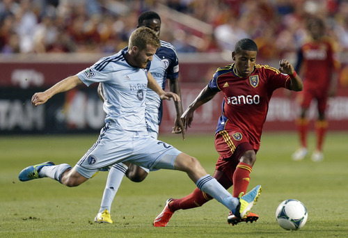 Sporting Kansas City's Oriol Rosell (20) defends against Real Salt Lake's Joao Plata, right, in the first half during an MLS soccer game on Saturday, July 20, 2013, in Sandy, Utah. (AP Photo/Rick Bowmer)