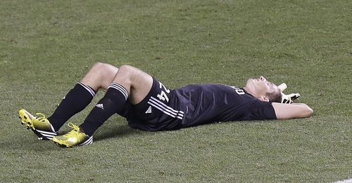 Real Salt Lake goalkeeper Kyle Reynish (24) lays out on the ground at the end of their MLS soccer game against Sporting KC Saturday, July 20, 2013, in Sandy, Utah. Sporting KC defeated Real Salt Lake 2-1. (AP Photo/Rick Bowmer)