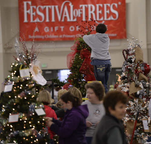 Al Hartmann  |  The Salt Lake Tribune People fill the South Towne Exposition Center in Sandy Monday morning December 2 to decorate Christmas trees for the Festival of Trees event to raise money for Primary Children's Medical Center. The festival will be open to the public on Wednesday starting at 10 a.m.