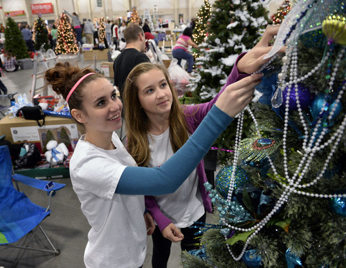 "Al Hartmann  |  The Salt Lake Tribune Aubrey Slack, 19, left, and Emma Heidelberger, 12, who both suffer from postural orthostatic tachycardia syndrome, or POTS, a debilitating but fairly unknown disease, finish decorating a tree at the Festival of Trees Monday December 2 . It's to raise awareness of POTS and raise money for Primary Children's Medical Center.  Their tree's theme is ""Breakfast at Tiffany's.""  The two girls met this fall and now are each other's support. Aubrey was diagnosed four years ago, but Emma was just diagnosed in early October."