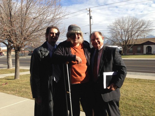 | Courtesy David Musselman David Musselman, 45, of Taylorsville, seen here with JR Musselman, left, and Lynn Barker, right, decided to dress as a down-on-his-luck homeless man to drive home the lesson of compassion this holiday season to his Mormon flock.