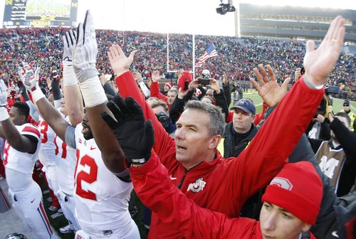 Ohio State head coach Urban Meyer joins his team in singing the school's alma mater after their 42-41 win over Michigan in an NCAA college football game Saturday, Nov. 30, 2013 at Michigan Stadium in Ann Arbor, Mich. (AP Photo/Detroit Free Press,  Julian H. Gonzalez) DETROIT NEWS OUT;  NO SALES, MANDATORY CREDIT