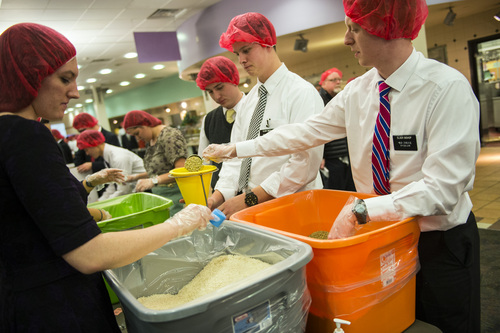 Chris Detrick  |  The Salt Lake Tribune Mormon missionaries Jesse Bishop, Taylor Smith, Baxter Elwood and Kate Wigginton work at preparing meals at the Missionary Training Center in Provo Thursday November 28, 2013.  The 1,800 missionaries spent Thanksgiving by preparing 350,000 meals for hungry Utah children. The packages of nutritious, nonperishable food will be provided to Utah schools where they are sent home with children in need.