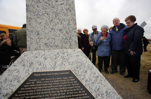 Francisco Kjolseth  |  The Salt Lake Tribune Wanda Shields Naylor, with a hand on her chest, is joined by Lamar Mabey and Joyce Nelson Holder at the unveiling ceremony at Heritage Park in South Jordan for a 75th anniversary of the Dec. 1, 1938, school bus/train crash accident that killed 26 people, including 25 students. All three were directly impacted by the tragedy.