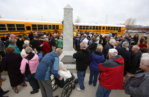 Francisco Kjolseth  |  The Salt Lake Tribune Friends, family and relatives gather at Heritage Park in South Jordan for a 75th anniversary unveiling ceremony dedicated to a Dec. 1, 1938, school bus/train crash accident that killed 26 people, including 25 students.