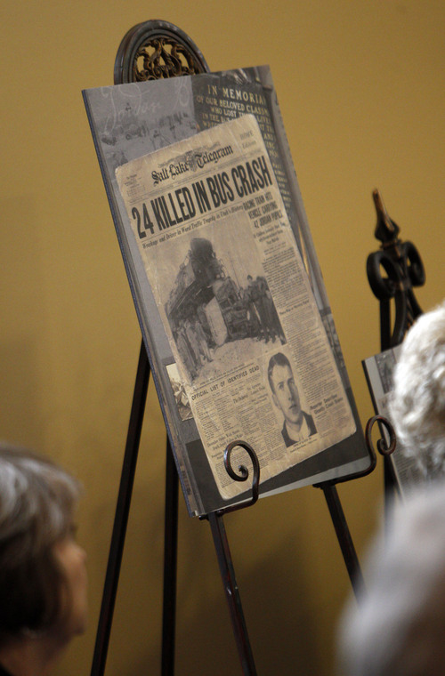 Francisco Kjolseth  |  The Salt Lake Tribune Old newspaper clippings tell the tragic story as friends, family and relatives gather at Heritage Park Community Center in South Jordan for a 75th anniversary unveiling ceremony dedicated to a Dec. 1, 1938, school bus/train crash accident that killed 26 people, including 25 students.
