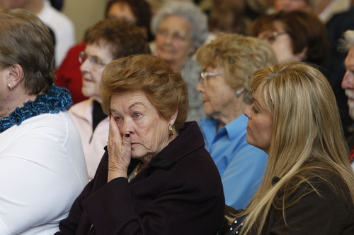 Francisco Kjolseth  |  The Salt Lake Tribune Sherrie Silcox, daughter-in-law to Farrold H. Silcox who was the bus driver of a tragic accident 75-years ago, wipes away tears as she remembers the tragedy alongside many others. Family, friends and relatives gathered at Heritage Park Community Center in South Jordan for a 75th anniversary unveiling ceremony dedicated to the Dec. 1, 1938, school bus/train crash accident that killed 26 people, including 25 students.