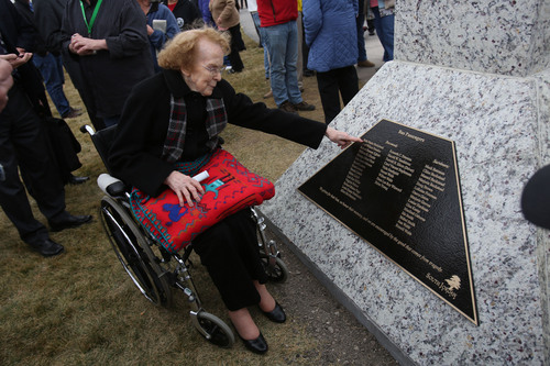 Francisco Kjolseth  |  The Salt Lake Tribune LaRoyce Fisher, 89, touches her sister's name at Heritage Park in South Jordan for the 75th anniversary unveiling ceremony dedicated to a Dec. 1, 1938, school bus/train crash accident that killed 26 people, including 25 students. Fisher lost her sister Rela Marie Beckstead in the accident.