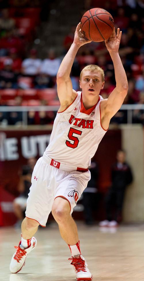 Trent Nelson  |  The Salt Lake Tribune Utah's Parker Van Dyke (5) passes the ball as the University of Utah hosts Ball State, NCAA basketball Wednesday November 27, 2013 at the Huntsman Center in Salt Lake City.