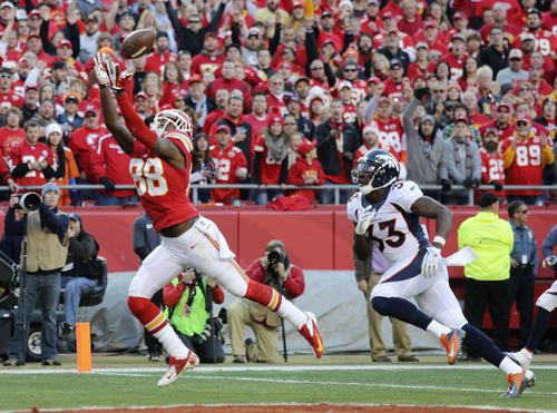 Kansas City Chiefs wide receiver Junior Hemingway (88) makes a touchdown reception against Denver Broncos strong safety Duke Ihenacho (33) during the first half of an NFL football game, Sunday, Dec. 1, 2013, in Kansas City, Mo. (AP Photo/Ed Zurga)