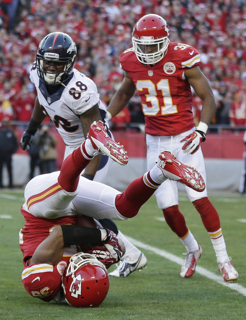 Kansas City Chiefs defensive back Quintin Demps (35) intercepts a pass intended for Denver Broncos wide receiver Demaryius Thomas (88) during the first half of an NFL football game, Sunday, Dec. 1, 2013, in Kansas City, Mo. (AP Photo/Charlie Riedel)