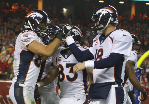 Ed Zurga | The Associated Press Denver receiver Eric Decker, left, celebrates a touchdown with quarterback Peyton Manning during the second half of the Broncos' 35-28 victory over Kansas City. Decker caught four touchdowns from Manning on Sunday.