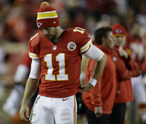 Kansas City Chiefs quarterback Alex Smith (11) looks down as he watches from the sideline near the end of an NFL football game against the Denver Broncos, Sunday, Dec. 1, 2013, in Kansas City, Mo. The Broncos won 35-28. (AP Photo/Charlie Riedel)