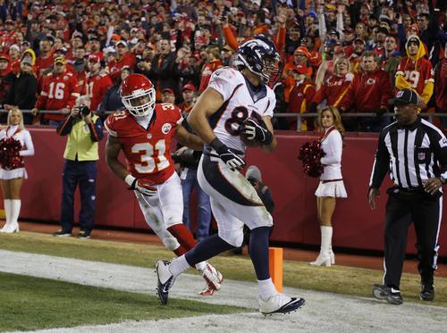 Denver Broncos wide receiver Eric Decker (87) makes a touchdown against Kansas City Chiefs cornerback Marcus Cooper (31) during the second half of an NFL football game, Sunday, Dec. 1, 2013, in Kansas City, Mo. (AP Photo/Ed Zurga)