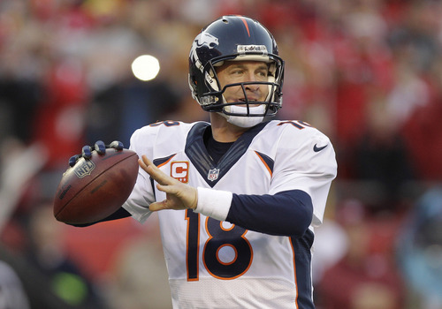 Denver Broncos quarterback Peyton Manning (18) throws a pass during the first half of an NFL football game against the Kansas City Chiefs, Sunday, Dec. 1, 2013, in Kansas City, Mo. (AP Photo/Ed Zurga)