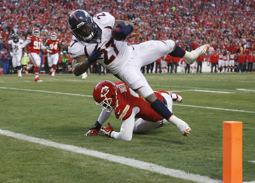 Denver Broncos running back Knowshon Moreno (27) dives into the end zone for a touchdown against Kansas City Chiefs cornerback Sean Smith (27) during the first half of an NFL football game, Sunday, Dec. 1, 2013, in Kansas City, Mo. (AP Photo/Ed Zurga)