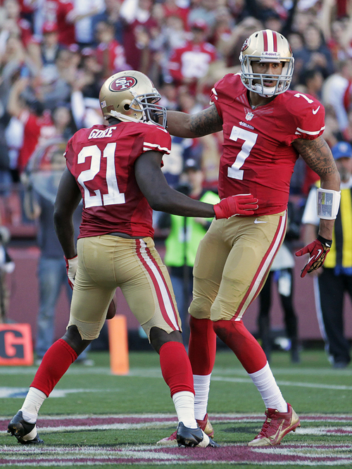 San Francisco 49ers running back Frank Gore (21) celebrates with quarterback Colin Kaepernick (7) after running for a 3-yard touchdown during the second quarter of an NFL football game against the St. Louis Rams in San Francisco, Sunday, Dec. 1, 2013. (AP Photo/Tony Avelar)