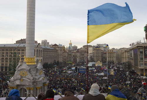 Ukrainian national flag waves as protesters rally at the central Independence square in Kiev, Ukraine, on Tuesday, Dec. 3, 2013. Ukraine's opposition failed Tuesday to force out the government with a no-confidence vote in parliament, leaving the country's high political tensions unresolved, and with some thousands of people demonstrating on the streets of the capital. (AP Photo/Ivan Sekretarev)