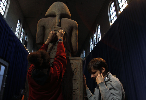 In this Monday Nov. 25, 2013 photo, Angel Ayala, left, and Austin Seraphin touch a quartzite likeness of Ramesses II  at the Penn Museum in Philadelphia.  Ayala, 16 and blind since birth, touched ancient Egyptian artifacts at the University of Pennsylvania archaeology museum as part of a special tour for the blind and visually impaired. Seraphin is also blind and helped develop the tour.   (AP Photo/Jacqueline Larma)