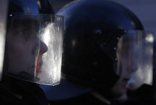 Police stand guard outside the Parliament in Kiev, Ukraine, on Tuesday, Dec. 3, 2013. Ukraine's parliament on Tuesday opened a high-tension session in which the opposition aims to put forward a vote of no-confidence in the government in the wake of both the president's shelving an agreement with the European Union and police violence against demonstrators protesting that decision. (AP Photo/Sergei Grits)