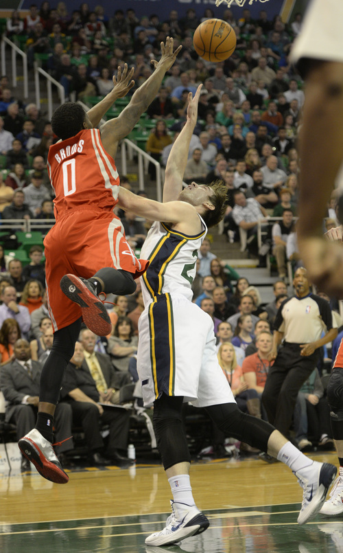 Rick Egan    The Salt Lake Tribune   Utah Jazz shooting guard Gordon Hayward (20) scores on the play, as he is fouled by Houston Rockets point guard Aaron Brooks (0), in NBA action, Utah Jazz vs. the Houston Rockets, at the EnergySolutions Arena, Monday, December 2, 2013.