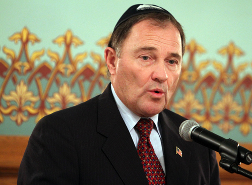 Keith Johnson | The Salt Lake Tribune  Utah governor Gary Herbert speaks at the menorah-lighting ceremony at the Governor's Mansion, December 2, 2013 in Salt Lake City. Community and religious leaders representing many faiths were present for the event.