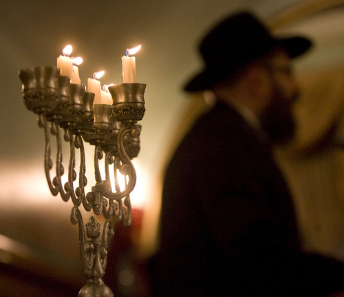 Keith Johnson | The Salt Lake Tribune  Rabbi Benny Zippel of Chabad Lubavitch of Utah presides over the menorah-lighting ceremony at the Governor's Mansion, December 2, 2013 in Salt Lake City. Community and religious leaders representing many faiths were present for the event.