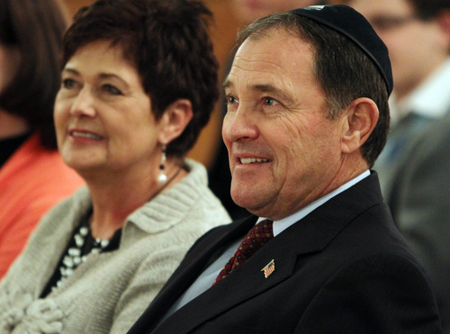 Keith Johnson | The Salt Lake Tribune  Utah governor Gary Herbert and his wife Jeanette attend the menorah-lighting ceremony at the Governor's Mansion, December 2, 2013 in Salt Lake City. Community and religious leaders representing many faiths were present for the event.