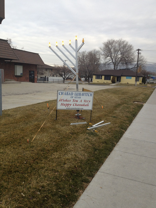 "Around 1 a.m. Sunday, someone broke several candles off the menorah that is on display in front of Chabad Lubavitch of Utah, 1760 S. 1100 East. Rabbi Benny Zippel, the centerís executive director, suspects ""some passing thugs"" were responsible. Courtesy Chabad Lubavitch"