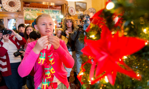Trent Nelson  |  The Salt Lake Tribune Students from the Chinese immersion program at Stewart Elementary decorated a Christmas tree at the governor's mansion in Salt Lake City, Tuesday December 3, 2013. Maren Bailey is at left.