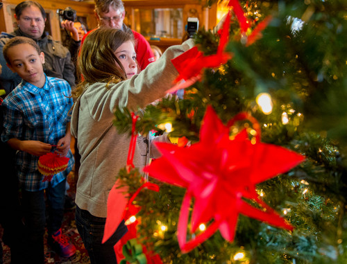 Trent Nelson  |  The Salt Lake Tribune Students from the Chinese immersion program at Stewart Elementary decorated a Christmas tree at the governor's mansion in Salt Lake City, Tuesday December 3, 2013. Ellie Campbell is at right, Kaden Mitchell is at left.
