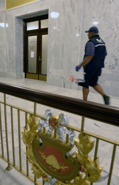 Al Hartmann  |  The Salt Lake Tribune On Monday, Dec. 2, the entrance to the Utah attorney general's office at the Utah Capitol looked like a ghost town. At midday, the only person entering the office was a FedEx delivery man. Paul Murphy, director of communications with the office, said John Swallow's office was empty and that he had removed his belongings over the weekend. Swallow's resignation was to take effect Tuesday at 12:01 a.m.