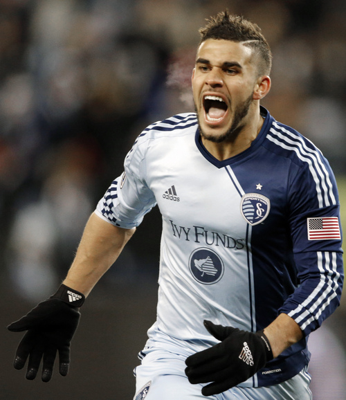 Sporting KC forward Dom Dwyer celebrates his goal during the second half of an MLS playoff soccer match against the Houston Dynamo in Kansas City, Kan., Saturday, Nov. 23, 2013. Sporting KC defeated Houston Dynamo 2-1. (AP Photo/Orlin Wagner)