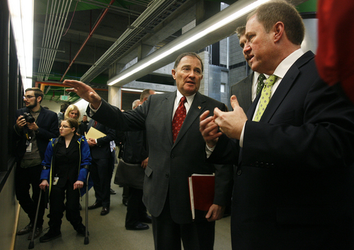 Scott Sommerdorf   |  The Salt Lake Tribune Utah Governor Gary Herbert tours a computer technology / robotics lab at UVU as he speaks with UVU Dean Michael Savoie, right. The Governor had just released his fiscal year 2014 budget recommendations at Utah Valley University, Wednesday December 4, 2013.