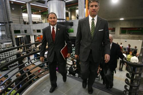 Scott Sommerdorf   |  The Salt Lake Tribune Utah Governor Gary Herbert tours UVU with President Matthew Holland, right, after Herbert released his fiscal year 2014 budget recommendations at Utah Valley University, Wednesday December 4, 2013.