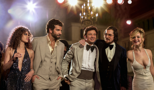 """This film image released by Sony Pictures shows, from left,  Amy Adams, Bradley Cooper, Jeremy Renner, Christian Bale and Jennifer Lawrence in a scene from """"American Hustle."""" While shooting in Boston, David O. Russell's upcoming fictionalization of the Abscam investigation, """"American Hustle,"""" found itself caught up in the Boston Marathon bombing. When the city was essentially shut down for the manhunt, the production had to be stopped for a day. The experience, Russell says, was felt closely by the production. (AP Photo/Sony - Columbia Pictures, Francois Duhamel)"""