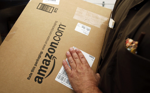 FILE - In this Oct. 18, 2010 file photo, an Amazon.com package is prepared for shipment by a United Parcel Service driver in Palo Alto, Calif. (AP Photo/Paul Sakuma, File)
