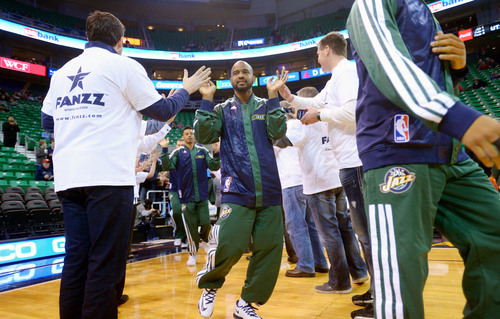 Steve Griffin  |  The Salt Lake Tribune   The Utah Jazz are greeted by fans as they take the court prior to their game against the Indiana Pacers at EnergySolutions Arena in Salt Lake City, Utah Wednesday, December 4, 2013.