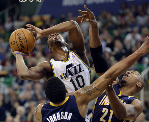 Steve Griffin  |  The Salt Lake Tribune   Utah Jazz point guard Alec Burks (10) powers his way past Indiana Pacers shooting guard Orlando Johnson (11) and Indiana Pacers power forward David West (21) and scores during first half action in the Utah Jazz versus Indiana Pacers at EnergySolutions Arena in Salt Lake City, Utah Thursday, December 5, 2013.