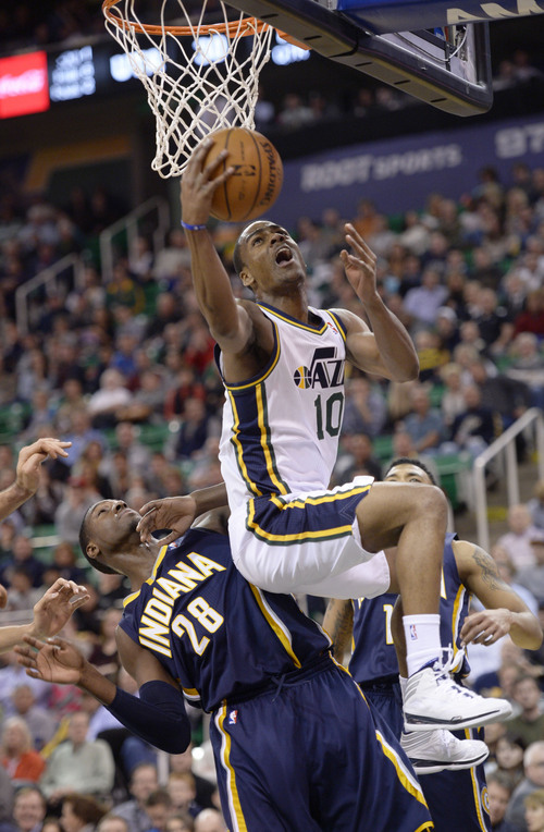Steve Griffin  |  The Salt Lake Tribune   Utah Jazz point guard Alec Burks (10) leaps over Indiana Pacers center Ian Mahinmi (28) s he gets to the basket during first half action in the Utah Jazz versus Indiana Pacers at EnergySolutions Arena in Salt Lake City, Utah Thursday, December 5, 2013.