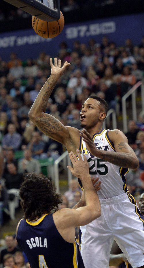 Steve Griffin  |  The Salt Lake Tribune   Utah Jazz shooting guard Brandon Rush (25) crashes into Indiana Pacers power forward Luis Scola (4) and is called for a charging foul during first half action in the Utah Jazz versus Indiana Pacers at EnergySolutions Arena in Salt Lake City, Utah Thursday, December 5, 2013.