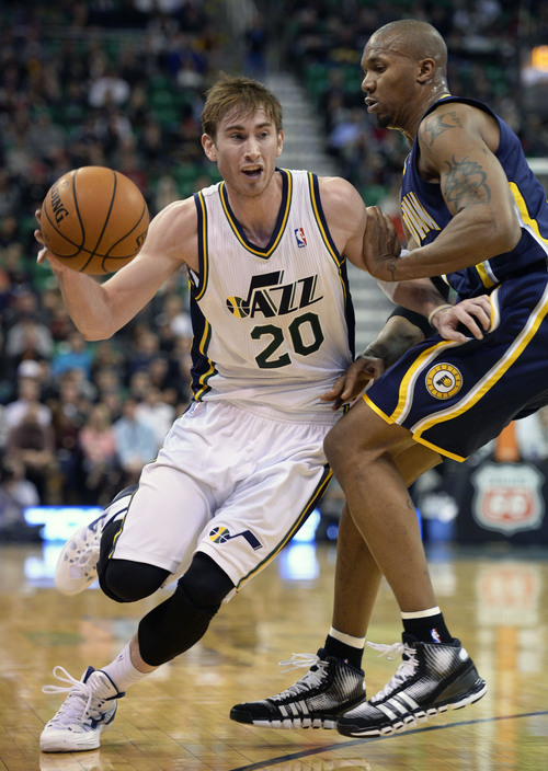 Steve Griffin  |  The Salt Lake Tribune   Utah Jazz shooting guard Gordon Hayward (20) drives past Indiana Pacers power forward David West (21) during first half action in the Utah Jazz versus Indiana Pacers at EnergySolutions Arena in Salt Lake City, Utah Thursday, December 5, 2013.