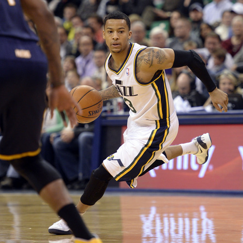 Steve Griffin  |  The Salt Lake Tribune   Utah Jazz point guard Trey Burke (3) dries into the lane during first half action in the Utah Jazz versus Indiana Pacers at EnergySolutions Arena in Salt Lake City, Utah Thursday, December 5, 2013.