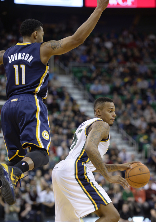 Steve Griffin  |  The Salt Lake Tribune   Utah Jazz shooting guard Brandon Rush (25) goes around a leaping Indiana Pacers shooting guard Orlando Johnson (11) during first half action in the Utah Jazz versus Indiana Pacers at EnergySolutions Arena in Salt Lake City, Utah Thursday, December 5, 2013.