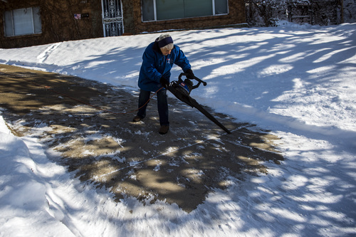 Chris Detrick  |  The Salt Lake Tribune Neva Paschal, 90, uses a leaf blower to clear the snow off of her driveway in Salt Lake City Wednesday Dec. 4, 2013.