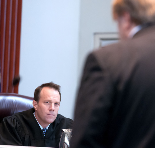 Justice Thomas R. Lee listens as  Craig T. Peterson presents oral arguments in the State v. Cody Nielsen, at the Utah Supreme Court, Thursday in Salt Lake City. Nielsen is serving a life sentence for murdering Trisha Autry and is appealing the conviction. (Eli Lucero/Herald Journal)
