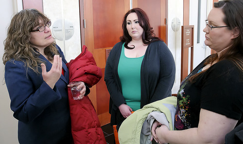 Assistant Attorney General Karen A. Klucznik, left, talks to Heather Autry and Breanne Autry following oral arguments in the State v. Cody Nielsen at the Utah Supreme Court, Thursday in Salt Lake City. Nielsen is serving a life sentence for murdering Trisha Autry, who is the sister of Heather and Breanne, and is appealing the conviction. (Eli Lucero/Herald Journal)