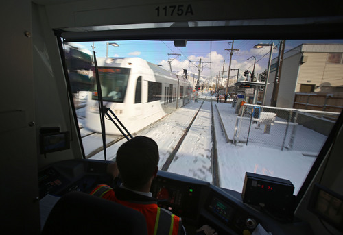 Francisco Kjolseth  |  The Salt Lake Tribune Train operator Mark Lococo passes a westbound streetcar while UTA has a media preview ride-along on the new Sugar House Streetcar on Wednesday, Dec. 4, 2013. Opening ceremonies are scheduled for Thursday and it opens to the public Saturday.