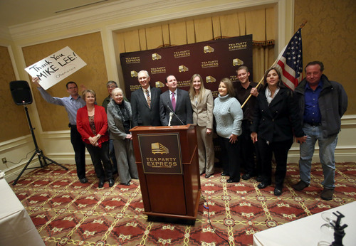 Francisco Kjolseth  |  The Salt Lake Tribune The Tea Party Express and grass roots activists gather for a staff picture with Senator Mike Lee following a press conference at the Grand America Hotel on Wednesday, Dec. 4, 2013.